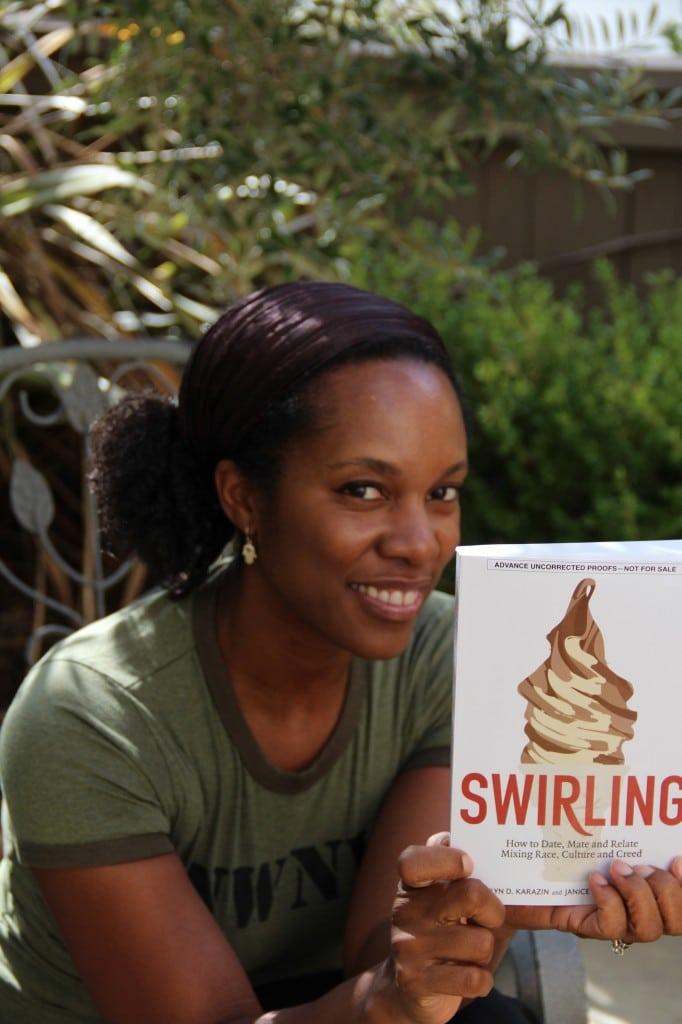 """Author Christelyn Karazin holding """"Swirling"""""""