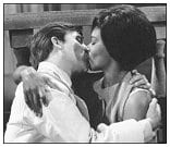 Surgeon Louise Mahler (Joan Hooley) and Doctor Giles Farmer (John White) sharing a passionate kiss.