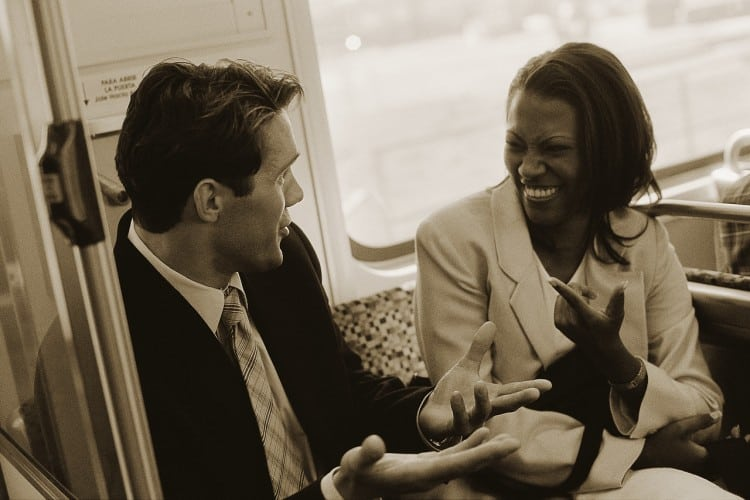 Business People Conversing on Train