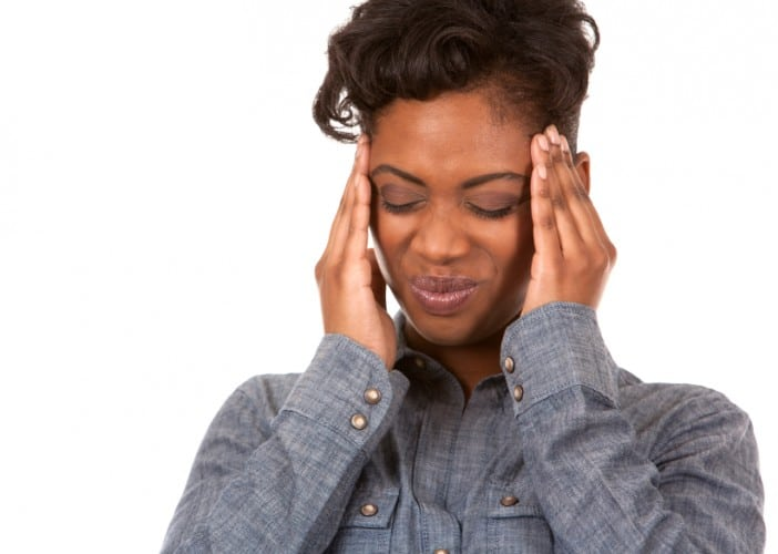 casual black woman with headache on white background