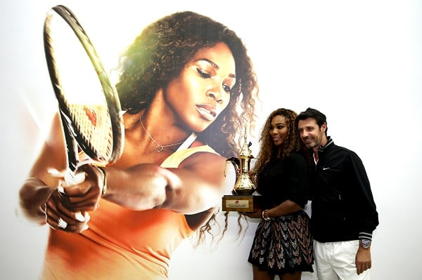 ISTANBUL, TURKEY - OCTOBER 25:  Serena Williams of the United States and coach Patrick Mouratoglou of France pose for photographers after the ceremony for the WTA Year End No. 1 Singles presented by Dubai Duty Free trophy during day four of the TEB BNP Paribas WTA Championships at the Sinan Erdem Dome on October 25, 2013 in Istanbul, Turkey.  (Photo by Matthew Stockman/Getty Images)