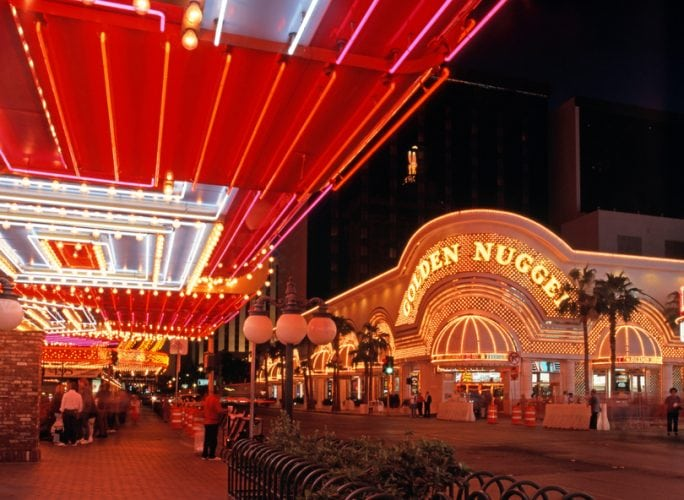 Las Vegas, United States - October 20, 1994: Golden Nugget casino in the downtown district at night with tourist walking by, Las Vegas, Nevada, USA.