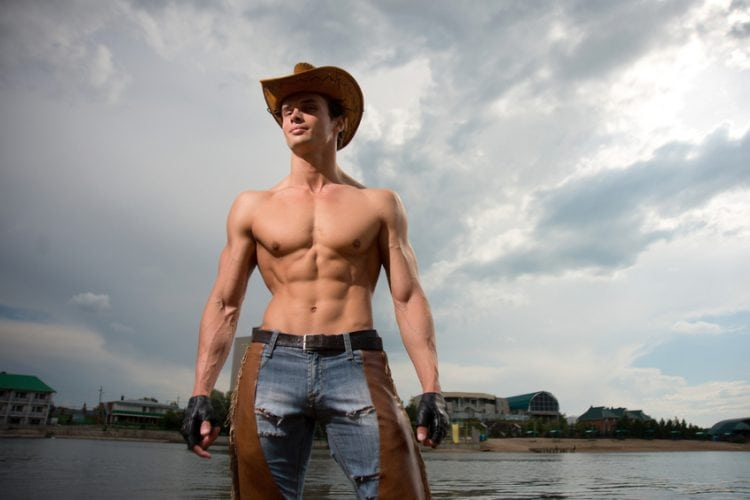 A young man in the image of a cowboy, muscular sexy man, sexy cowboy
