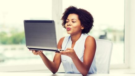 black woman blowing a kiss to her online date